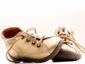 Trendy little golden baby shoes — Stock Photo