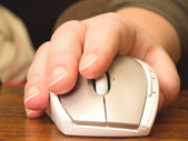 Human hand using computer mouse — Stock Photo