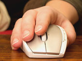 Human hand using scroll wheel on mouse — Stock Photo