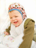 Cute happy baby boy sitting and laughing — Stock Photo