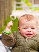 Baby boy showing off his flower — Stock Photo