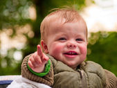 Happy baby boy pointing at you — Stock Photo