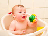 Cute baby boy enjoying a bath — Stock Photo