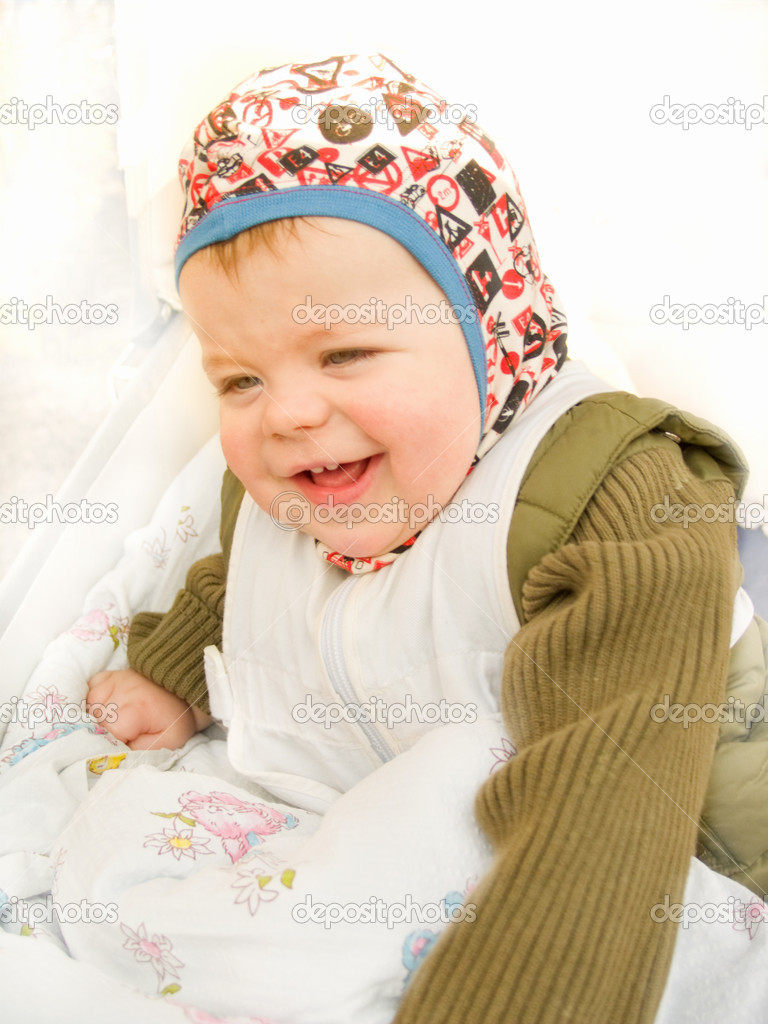 Cute happy baby boy sitting and laughing happily — Stock Photo #1460740