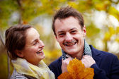 Love - Happy young couple smiling at you — Stock Photo