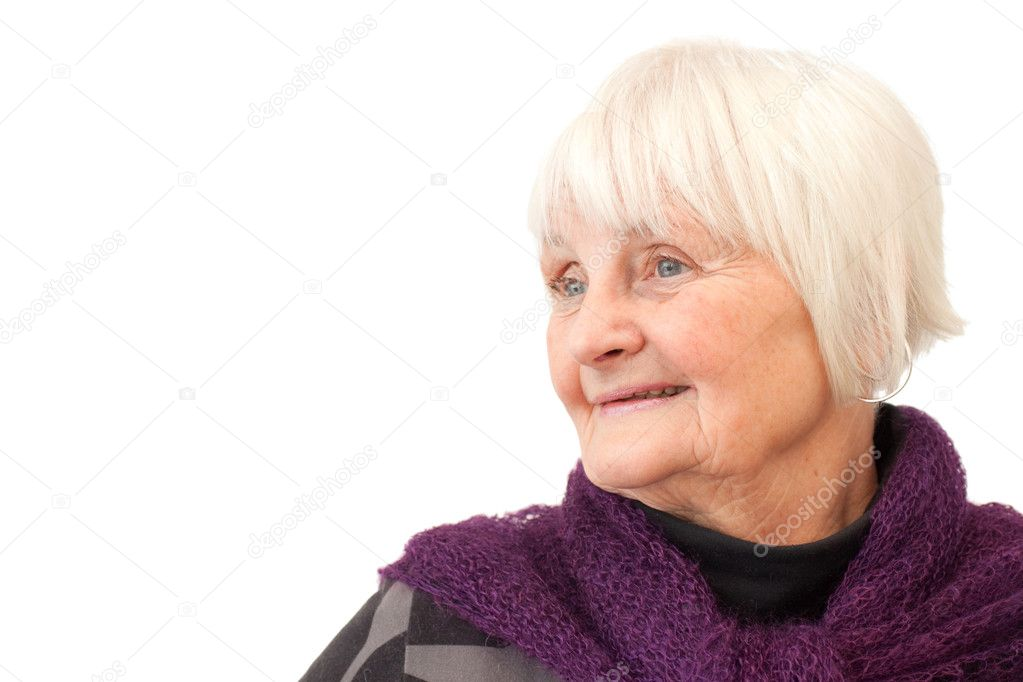 Thoughtful older woman reading a book  with white background — Stock Photo #1819348