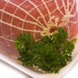Raw rolled meat - Stock Photo