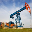 An oil pump jack - Stock Photo