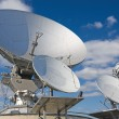 A large satellite dish aimed into space - Stock Photo