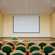 Auditorium hall with projection screen — Stock Photo