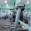 Room with gym equipment — Stock Photo