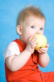 Baby boy eating an apple — Stock Photo