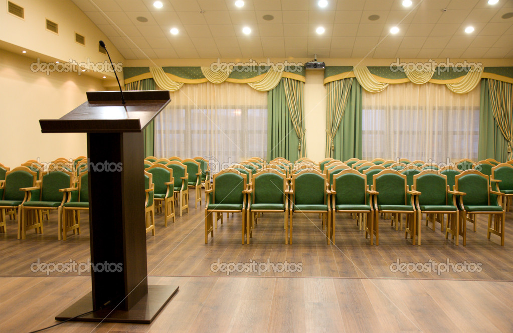 Modern auditorium hall for presentation with tribune — Stock Photo #1453080