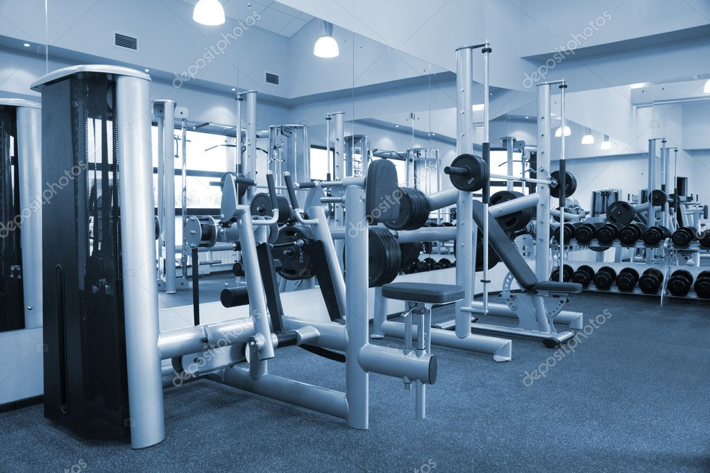 Room with gym equipment in the sport club — Stock Photo #1453157