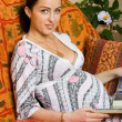 Happy pregnancy women sitting on sofa — Stockfoto