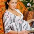 Happy pregnancy women sitting on sofa - Stock Photo