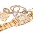 Golden watch, ring and necklace. — Stock Photo