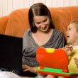 Mother and daughter using laptops — Stok fotoğraf