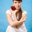 Royalty-Free Stock Photo: Attractive brunette with red rose