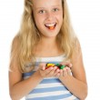Young smiling girl with chocolate candy — Stock Photo #1552293