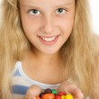 Young smiling girl with chocolate candy — Stock Photo #1552297