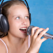 Pretty young girl singing — Stock Photo #1610091