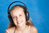 Young girl with headphones — Stock Photo