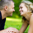 Attractive couple together on meadow — Stock Photo
