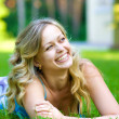 Young woman lying on a green grass — Stock Photo