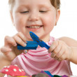 Girl playing with color play plasticine — Stock Photo #1956341