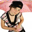 Young girl with umbrella sits on floor — Stock Photo #1956819
