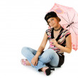 Young girl with umbrella sits on floor — Stock Photo #1956889