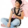 Young girl with umbrella sits on floor — Stock fotografie