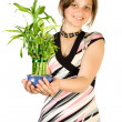 Young girl with home plant bamboo — Stock Photo #1957017
