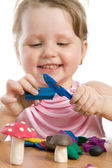 Girl playing with color play plasticine — Stock Photo