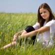 Young girl on a meadow — Stock Photo #1963555