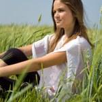 Sadness girl sitting on grass — Stock Photo