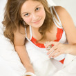 Young girl drinking tea in the bed — Stock Photo #1963990