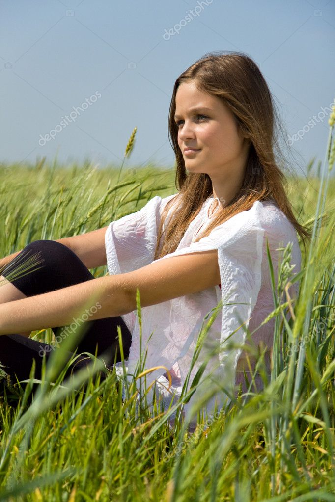 Sadness girl sitting on grass in park  Stock Photo #1963560