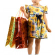 Stock Photo: Little girl with shopping bag.
