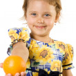 Little girl with orange. — Stock Photo