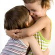 Smiling girl embraces a little boy — Stock Photo #2389050
