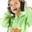 Little fun girl listening music — Stock Photo #2389100
