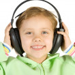 Little fun girl listening music — Stock Photo #2389106