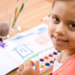 Pretty caucasian child paint watercolor — Stock Photo #2389126