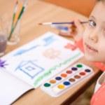 Pretty caucasian child paint watercolor — Stock Photo