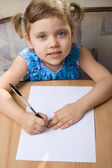 Small girl learns to write — Stock Photo