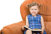 Little girl reading book and have fun — Stock Photo