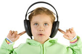 Surprised girl listening music — Stockfoto