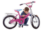 Young girl repair her bike — Stockfoto